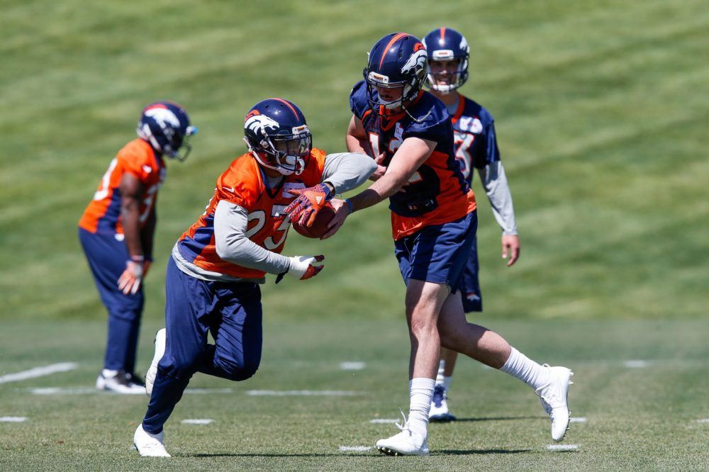 Denver Broncos quarterback Paxton Lynch (12) hands the ball off to running back Devontae Booker (23) during minicamp at UCHealth Training Center. Jun 13, 2017; Englewood. (Isaiah J. Downing/USA TODAY Sports)