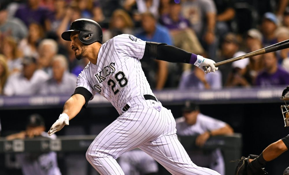 Colorado Rockies third baseman Nolan Arenado (28) hits a two run double in the eighth inning against the Chicago White Sox at Coors Field. Jul 7, 2017; Denver. (Photo: Ron Chenoy-USA TODAY Sports)