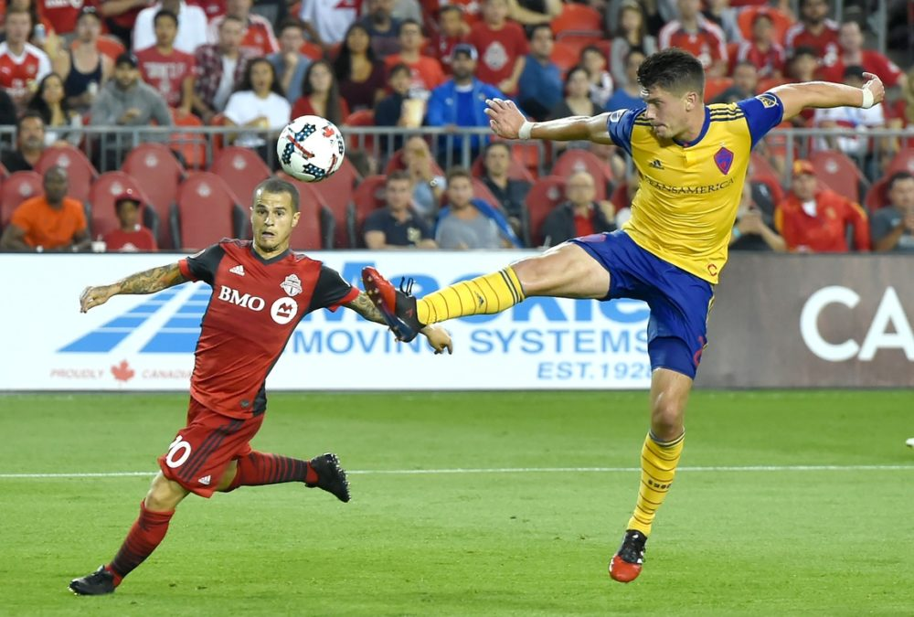 Colorado Rapids defender Mike Da Fonte (2) tips away a cross into his box intended for Toronto FC forward Sebastian Giovinco (10) in the second half at BMO Field. (Dan Hamilton/USA TODAY Sports)