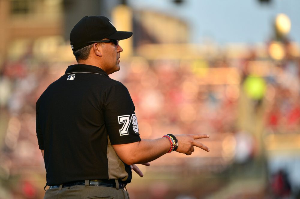 MLB umpire Manny Gonzalez (79) signals how many outs there are during the first inning of a game between the St. Louis Cardinals and the Colorado Rockies at Busch Stadium. Jul 25, 2017; St. Louis. (Jeff Curry/USA TODAY Sports)