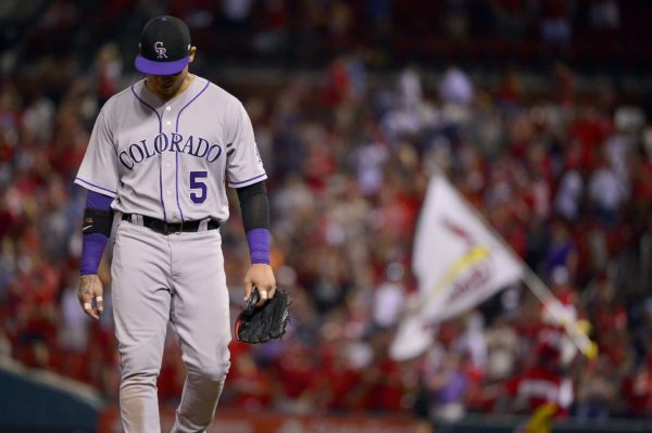 Rockies right fielder Carlos Gonzalez (5) walks off the field after he was unable to throw out St. Louis Cardinals center fielder Harrison Bader allowing him to score the winning run during the ninth inning at Busch Stadium. Jul 25, 2017; St. Louis. (Jeff Curry/USA TODAY Sports)