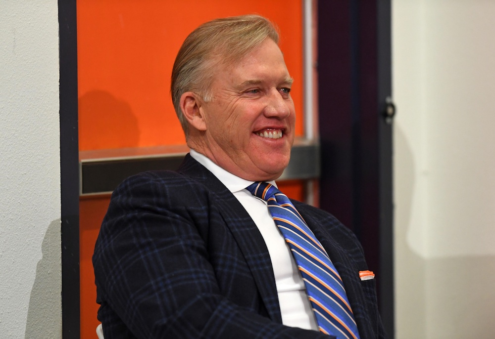 John Elway is reportedly earning close to $6 million a year under his new deal. (Ron Chenoy/USA Today Sports)