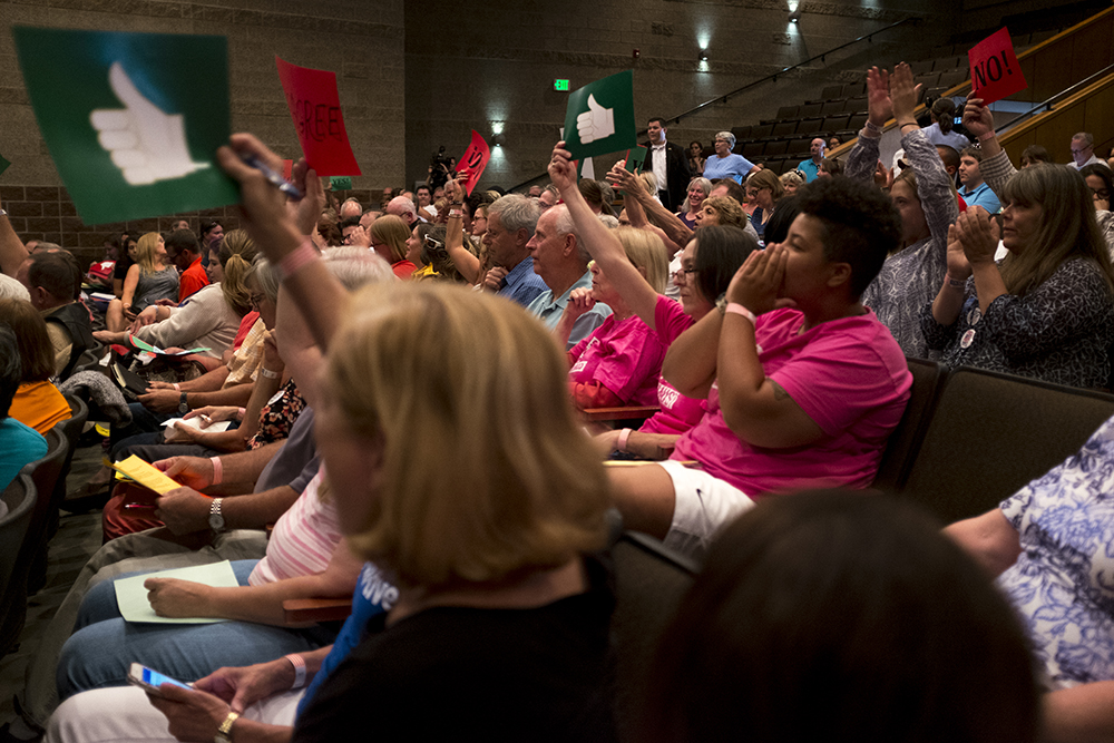 The audience erupts during Mike Coffman's second town hall meeting of this legislative session, Aug. 1, 2017. (Kevin J. Beaty/Denverite)  mike coffman; copolitics; denver; denverite; colorado; politics;