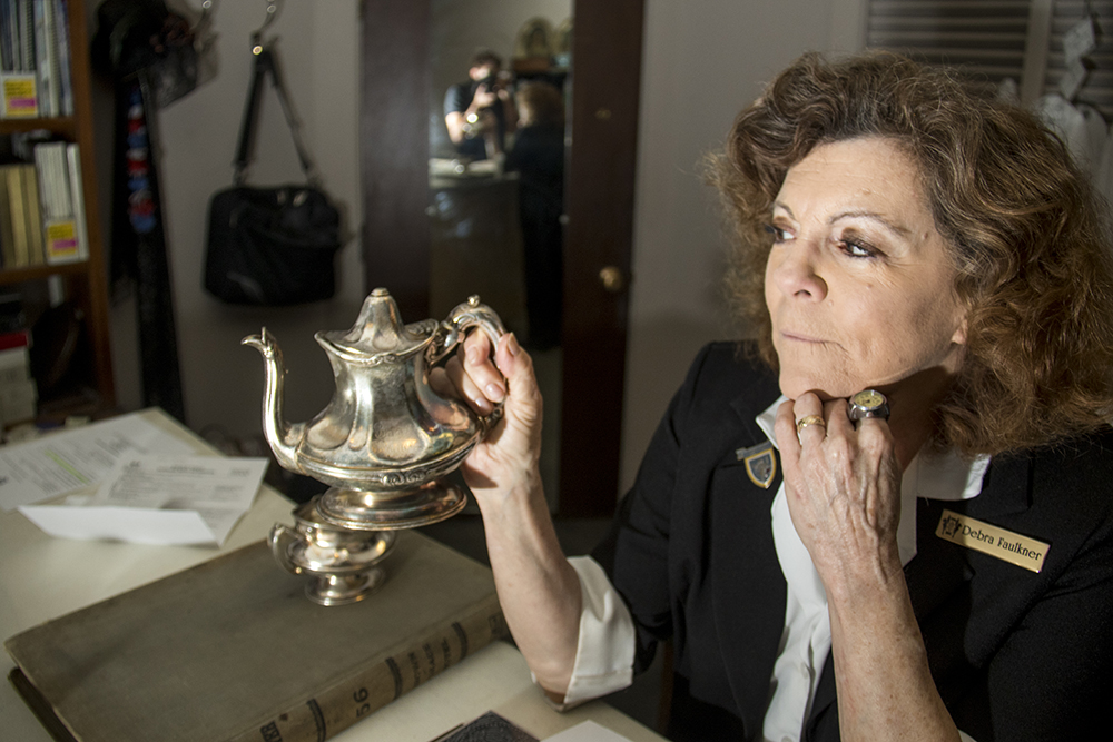 The Brown Palace Hotel's historian Debra Faulkner displays an old silver teapot that was stolen by newlyweds and returned on their 60th anniversary, Aug. 4, 2017. (Kevin J. Beaty/Denverite)  brown palace hotel; denver; colorado; denverite; kevinjbeaty;