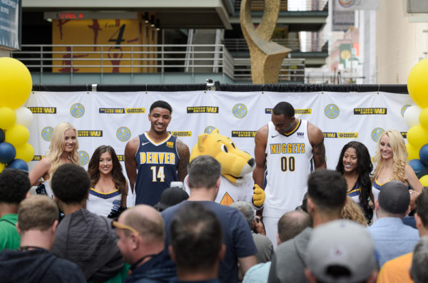 Gary Harris and Darrell Arthur show off the Nuggets' new uniforms Tuesday. (Austin Cope/Denverite)