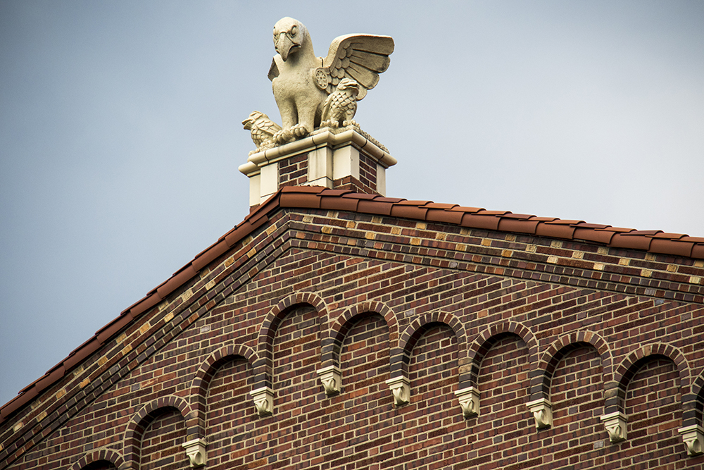 """Gertie Gargoyle"" perched atop South High School. (Kevin J. Beaty/Denverite)  high school; architecture; denver; colorado; denverite; kevinjbeaty; washington park;"
