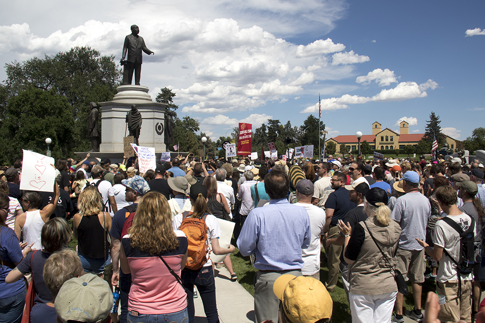 A rally in City Park in response to white supremacist protests in Charlottesville, VA, Aug. 13, 2017. (Kevin J. Beaty/Denverite)  protest; charlottesville; rally; denver; colorado; kevinjbeaty; denverite; city park