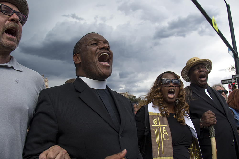 Religious leaders lead the march out of City Park. A rally in response to white supremacist protests in Charlottesville, VA, Aug. 13, 2017. (Kevin J. Beaty/Denverite)  protest; charlottesville; rally; denver; colorado; kevinjbeaty; denverite; city park