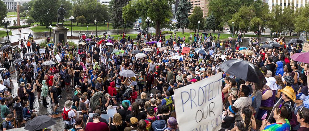 A rally in response to white supremacist protests in Charlottesville on the Capitol steps, beneath a controversial memorial to the Sand Creek Massacre. Aug. 13, 2017. (Kevin J. Beaty/Denverite)  protest; charlottesville; rally; denver; colorado; kevinjbeaty; denverite; capitol
