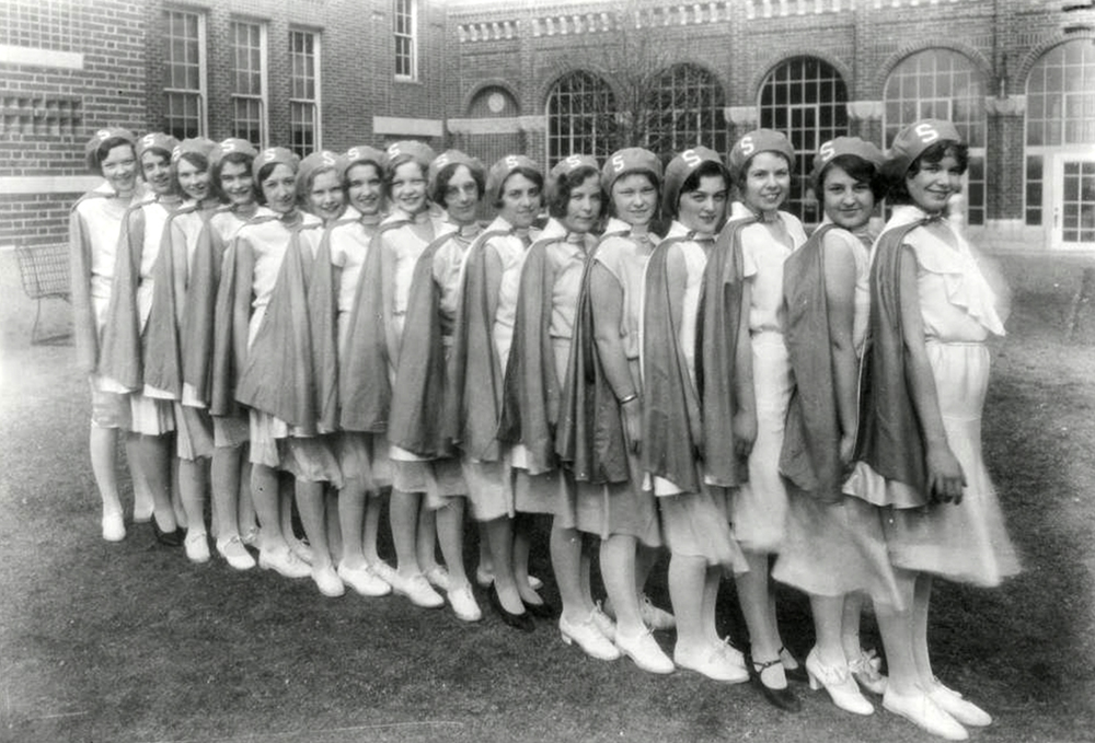Members of the Denver, Colorado South High School Pep Club Drill Team pose in their uniforms for a team photograph. (Denver Public Library/Western History Collection/WH1990)  high school; denver public library; dpl; archive; history;