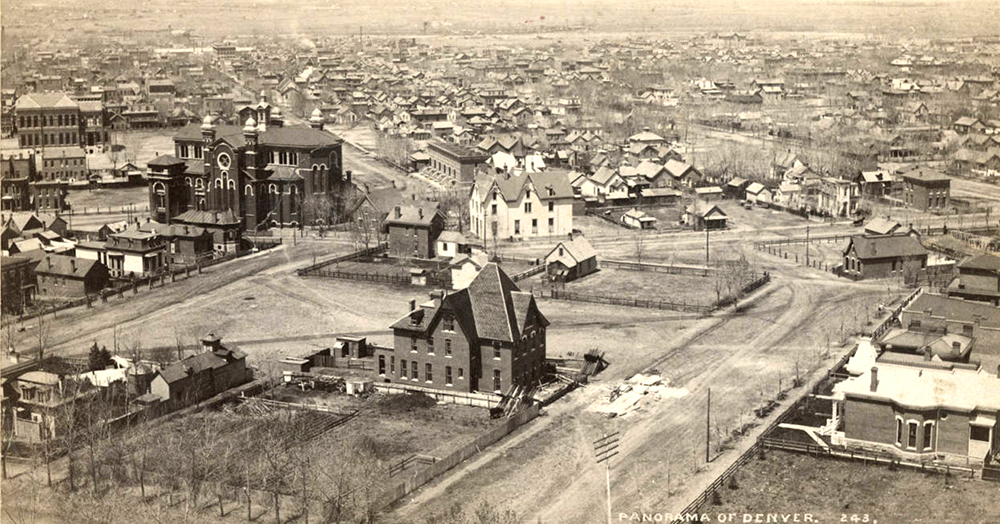 Aerial view of commercial buildings, houses and churches in downtown Denver, Colorado. Shows the Cathedral of Saint John the Evangelist (also called Saint John's Church in the Wilderness and St. John's Episcopal Cathedral) on 20th (Twentieth) and Welton Streets, and the Swedish Church. Distant landmarks include the First Presbyterian Church, Union Station, the Windsor Hotel, and East Side High School; a house is under construction in the foreground. Circa 1890. (William Henry Jackson/Denver Public Library/Western History Collection/Z-11777)  high school; denver public library; dpl; archive; history;