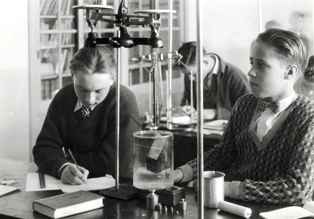 Students in the Physics Laboratory studying and working on an experiment at South High School in Denver, Colorado. (Denver Public Library/Western History Collection/WH1990)  high school; denver public library; dpl; archive; history;