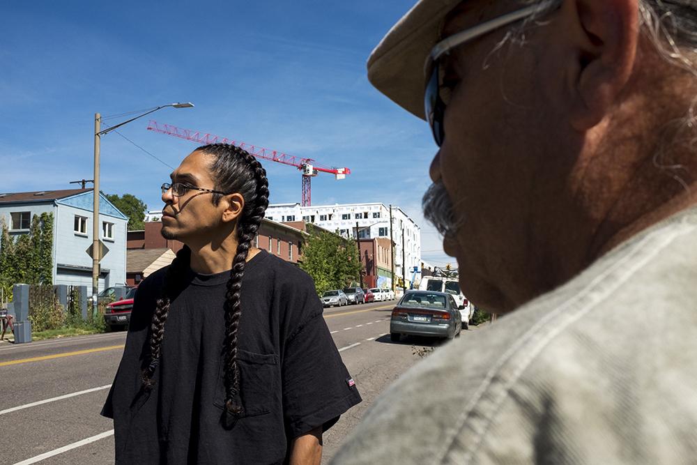 Long-time North Denver residents Ambrose Cruz and Sid Quintana stand on Tejon Street, Aug. 25, 2017. (Kevin J. Beaty/Denverite)  gentrification; highland; north denver; colorado; denver; denverite; kevinjbeaty;
