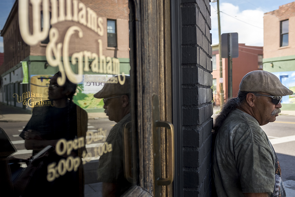 Long-time North Denver residents Ambrose Cruz and Sid Quintana stand outside of Williams & Graham on Tejon Street, Aug. 25, 2017. (Kevin J. Beaty/Denverite)