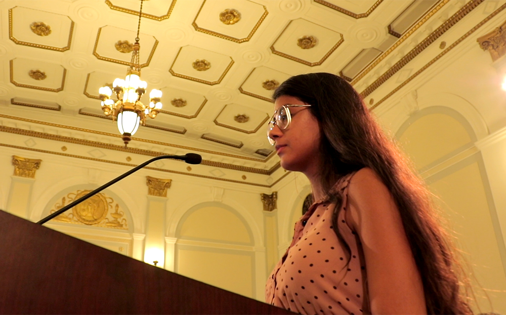"Alexa Bailon testifies during a Denver City Council hearing on the ""Public Safety Enforcement Priorities"" ordinance, Aug. 28, 2017. (Kevin J. Beaty/Denverite)  denver; city council; politics; sanctuary city; denverite; kevinjbeaty; colorado; city and county building;"