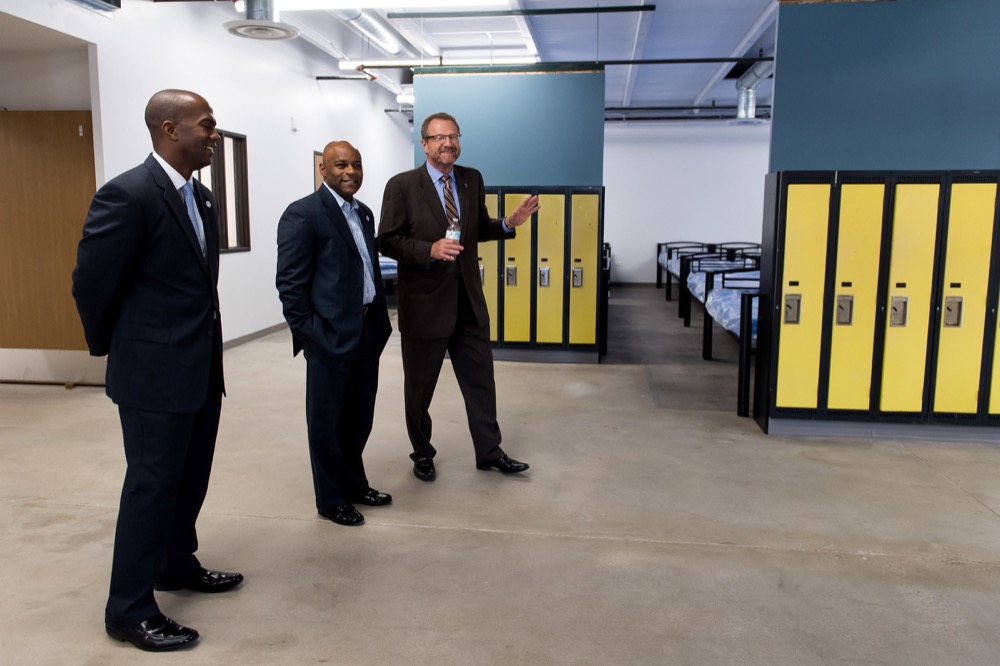 From left, Denver Councilman Chris Herndon and Mayor Michael Hancock take a tour of the new Samaritan House Women's Shelter with Catholic Charities President and CEO Larry Smith. (Photo courtesy The Catholic Alliance)
