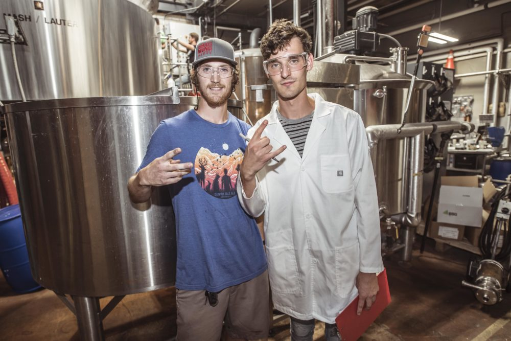 Great Divide Brewing Co. Packaging Supervisor Heath Michael and Grant Kwiecinski, aka GRiZ, (right) brewing Chasing the Golden Hour at Great Divide Brewing Co. (Courtesy of Jason Siegel/Great Divide Brewing Co.)