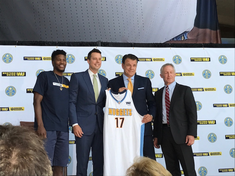 From left: Nuggets guard Malik Beasley, Nuggets president and governor Josh Kroenke, Western Union CEO Hikmet Ersek and Western Union executive vice president John Dye show off the new patch that will appear on the Nuggets' jerseys for the next three seasons. NOTE: This is not the jersey the Nuggets will wear in 2017-18. (Christian Clark/Denverite)
