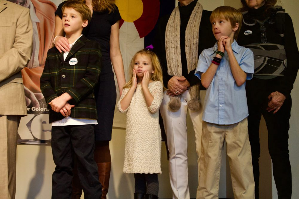 Former state Sen. Michael Johnston's children listen to him announce his gubernatorial bid. (Nic Garcia/Chalkbeat)