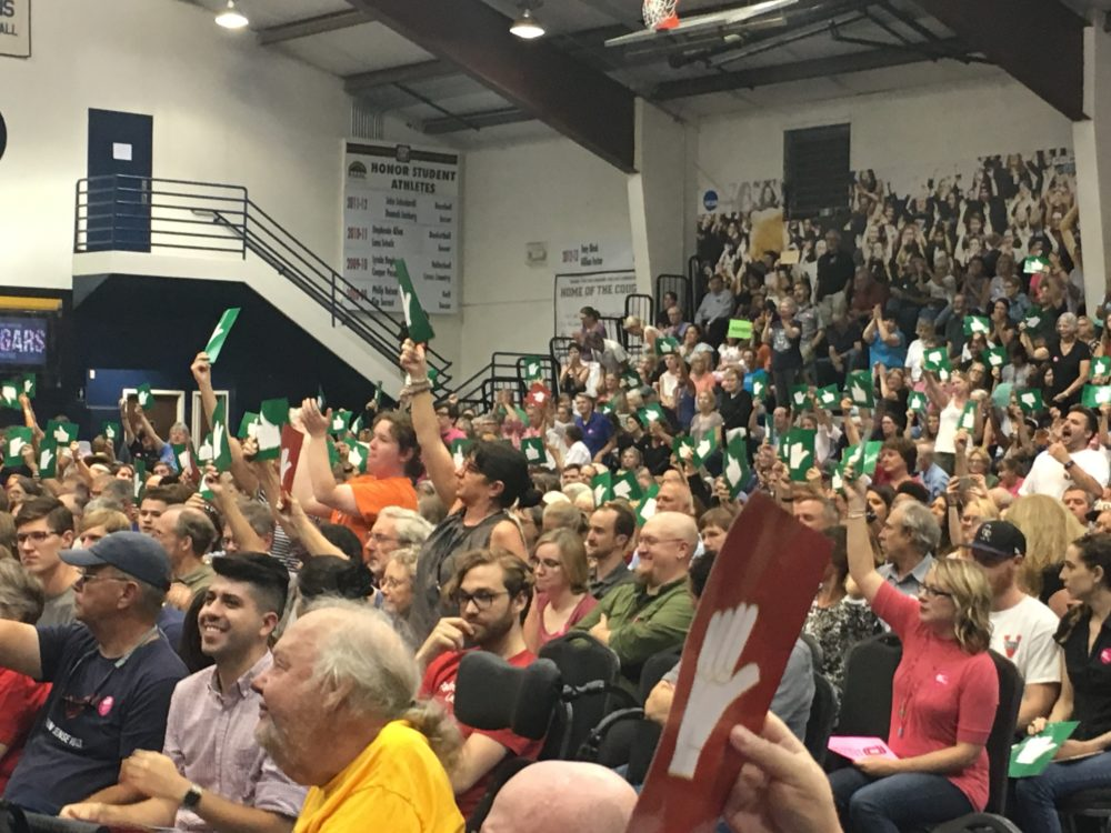 The crowd roars its approval when Sen. Cory Gardner was asked to call for the firing of presidential advisors seen to be sympathetic with white nationalists. Lakewood, Aug. 15, 2017. (Erica Meltzer/Denverite)