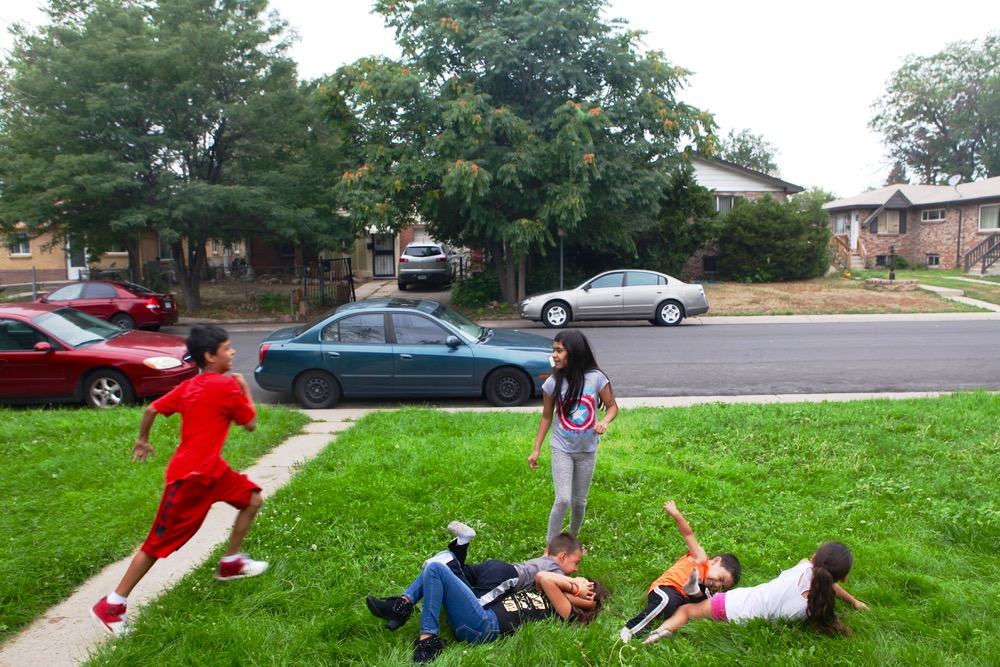 The Partida kids play outside their grandmother's house. (Andrew Kenney/Denverite)