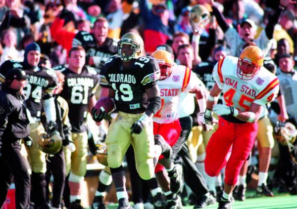 Rashaan Salaam goes over the 2,000-yard mark against Iowa State. (Rocky Mountain News Photograph Collection/Denver Public Library/Western History Collection/RMN-048-9135)