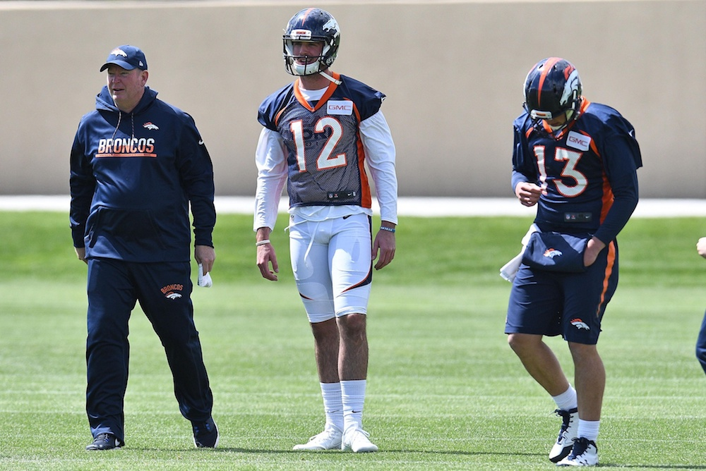 Paxton Lynch, center, and Trevor Siemian, right, will get their first preseason action of 2017 tonight in Chicago. (Ron Chenoy/USA Today Sports)