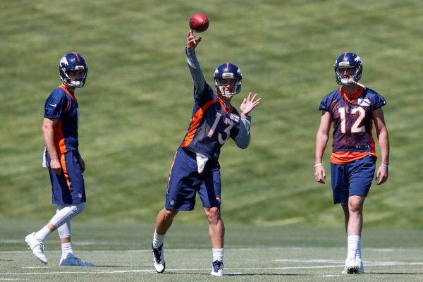 Trevor Siemian, right, and Paxton Lynch, center, are competing for the Broncos starting QB gig. (Isaiah J. Downing/USA Today Sports)