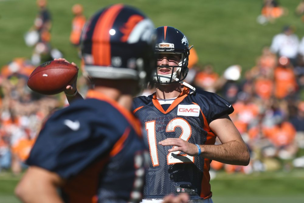 Denver Broncos quarterback Paxton Lynch (12) and quarterback Trevor Siemian warm up during training camp at the UCHealth Training Center. Jul 27, 2017; Englewood. (Ron Chenoy/USA TODAY Sports)