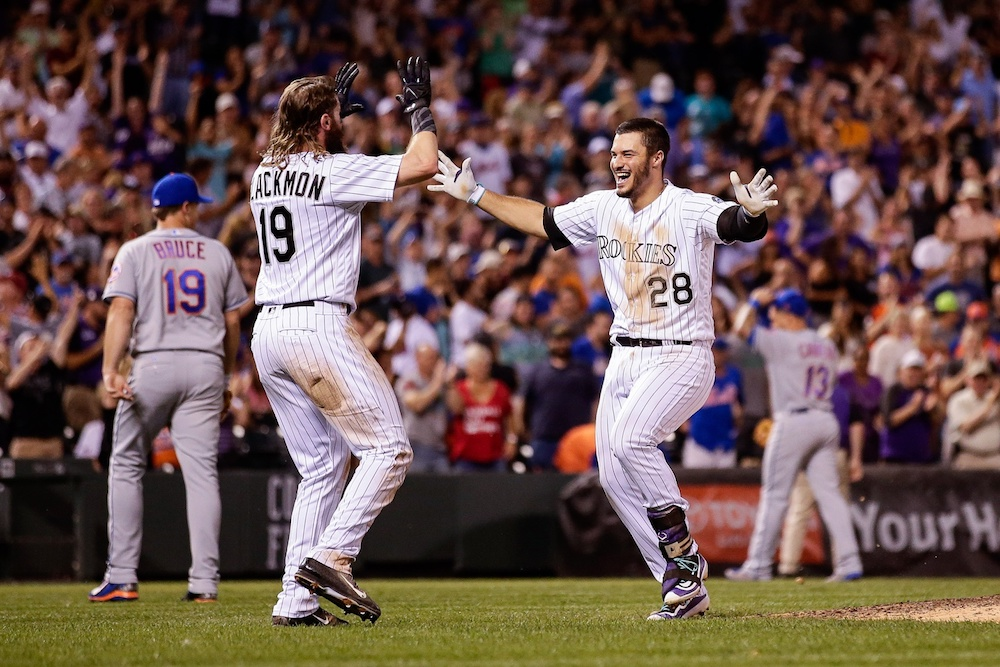 Nolan Arenado celebrates with Charlie Blackmon after his walk-off hit. (Isaiah J. Downing/USA Today Sports)