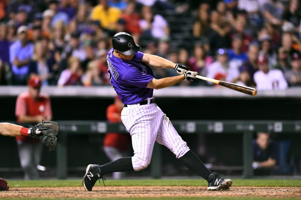 Colorado Rockies second baseman DJ LeMahieu (9) RBI singles in the eighth inning against the Philadelphia Phillies at Coors Field. Aug 4, 2017; Denver. (Ron Chenoy/USA TODAY Sports)