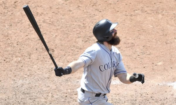 Charlie Blackmon watches his 12th inning homer. (Dave Richard/USA Today Sports)