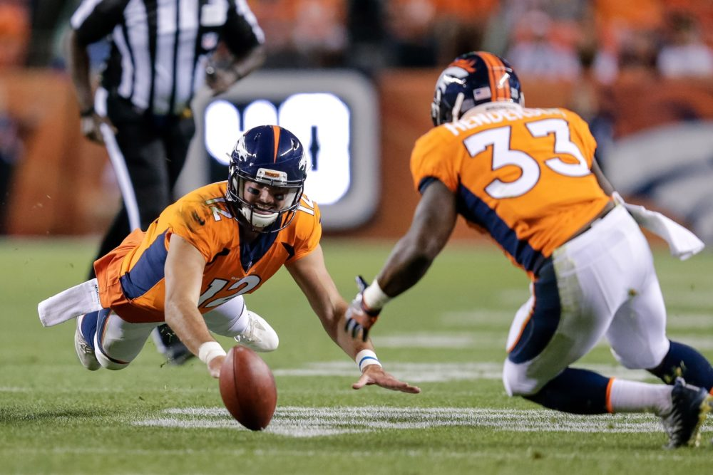 Denver Broncos quarterback Paxton Lynch (12) fumbles the ball as running back De'Angelo Henderson (33) recovers throws the ball in the third quarter against the Green Bay Packers at Sports Authority Field at Mile High. Aug 26, 2017; Denver, CO. (Isaiah J. Downing/)USA TODAY Sports)