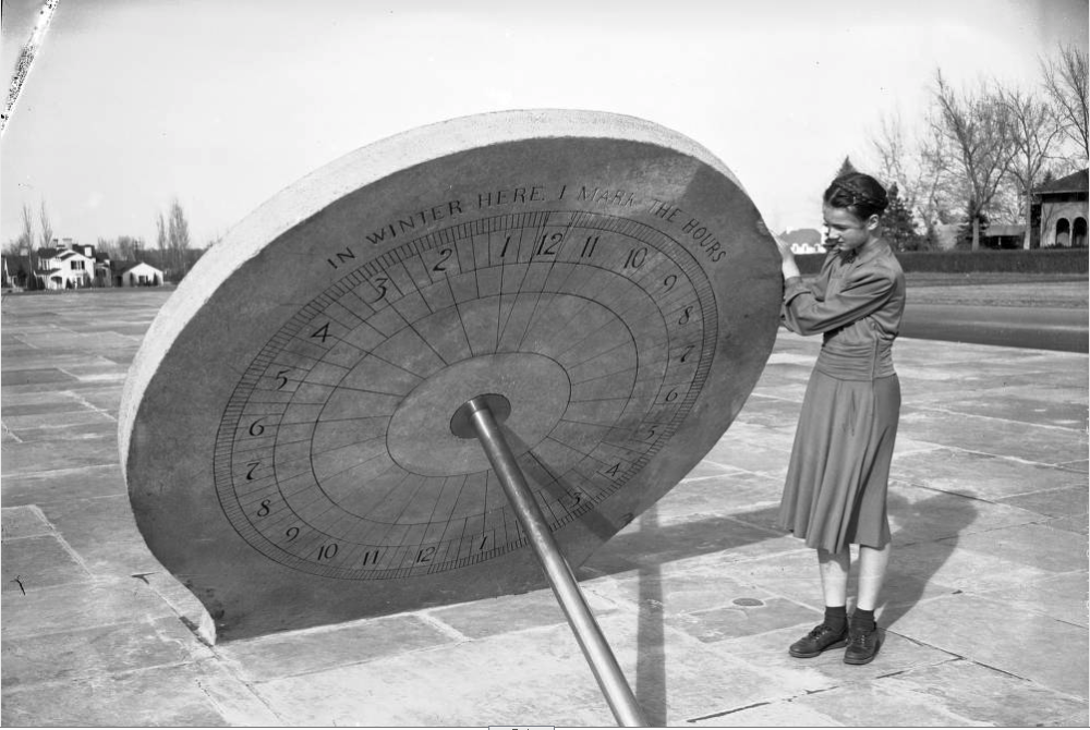A young woman stands next to the sundial in Cranmer Park in March 1941. The sundial still stands and the park is being rehabilitated. (Western History & Genealogy Dept./Denver Public Library)