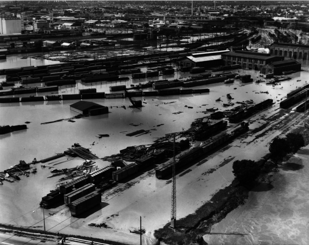An aerial view of the June 17, 1965 flood that ravaged Denver. The view includes the railyards south of 14th Street. (George Meister/Western History & Genealogy Dept./Denver Public Library/X-11000168O)