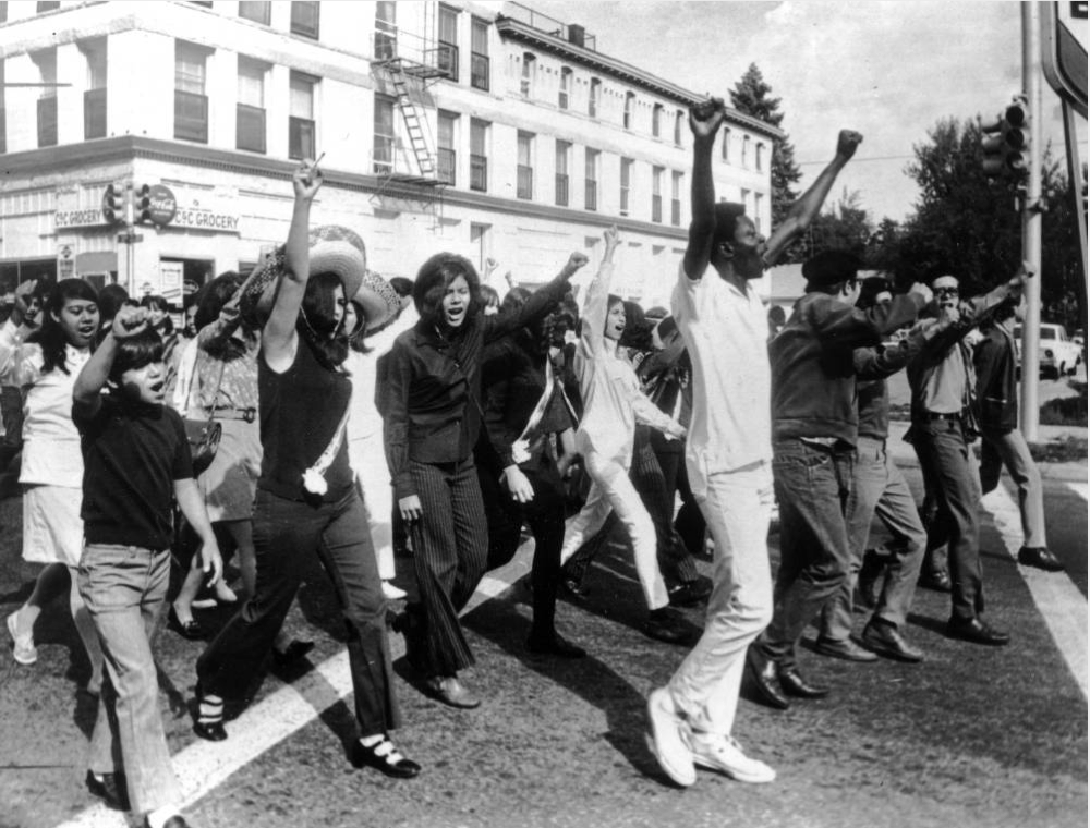 Men and women commemorate Mexican Independence Day on Sept. 16, 1969 near Zuni St. and 32nd Avenue. (Denver Public Library/Western History & Genealogy Dept./X-21666)
