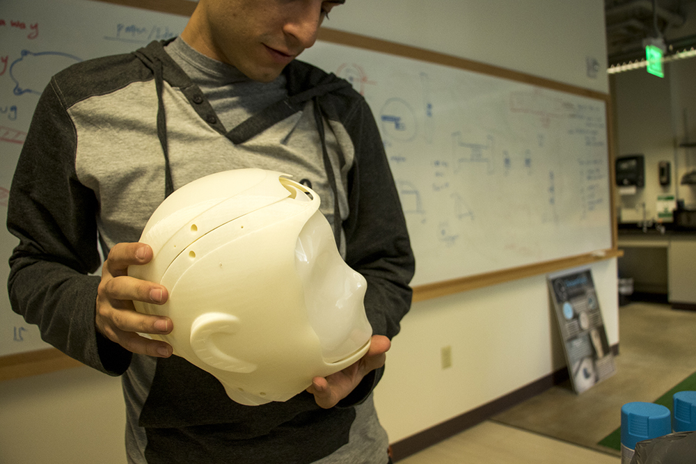 PhD student Hojjat Abdollahi holds the 3D-printed head of Ryan 2.0, which is still in development. Dr. Mohammad Mahoor's lab at the University of Denver where he and students are developing Ryan, the elder care robot, Sept. 22, 2017. (Kevin J. Beaty/Denverite)  elder care; robitics; university of denver; artificial intelligence; kevinjbeaty; denver; denverite; colorado;