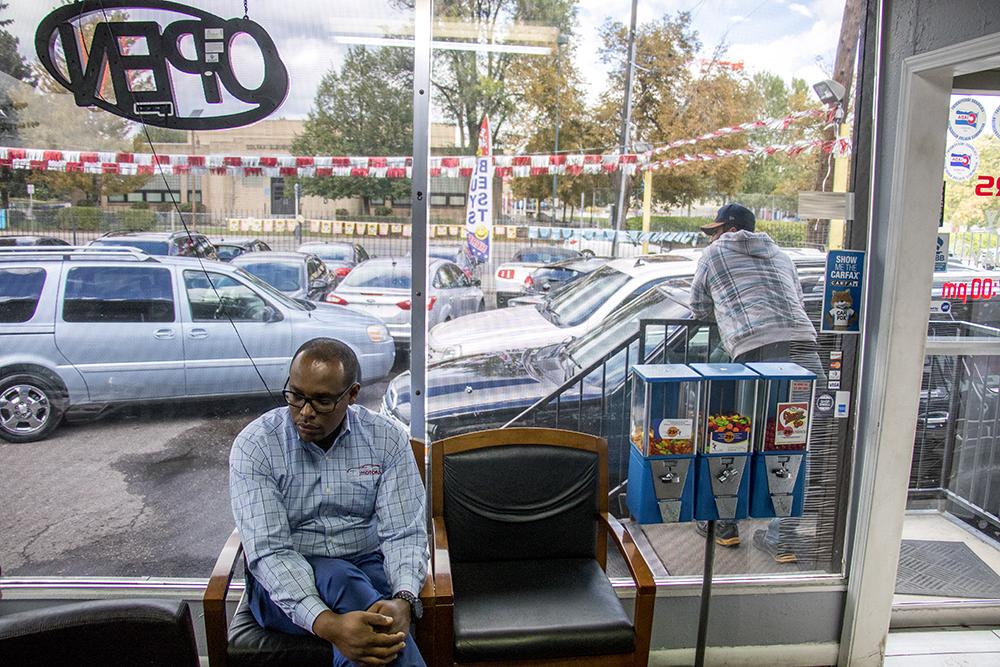 Henok Bedane inside his dealership, Ethio Motors, on West Colfax Avenue. Sept. 28, 2017. (Kevin J. Beaty/Denverite)  west colfax; denver; colorado; kevinjbeaty; denverite; car dealership;
