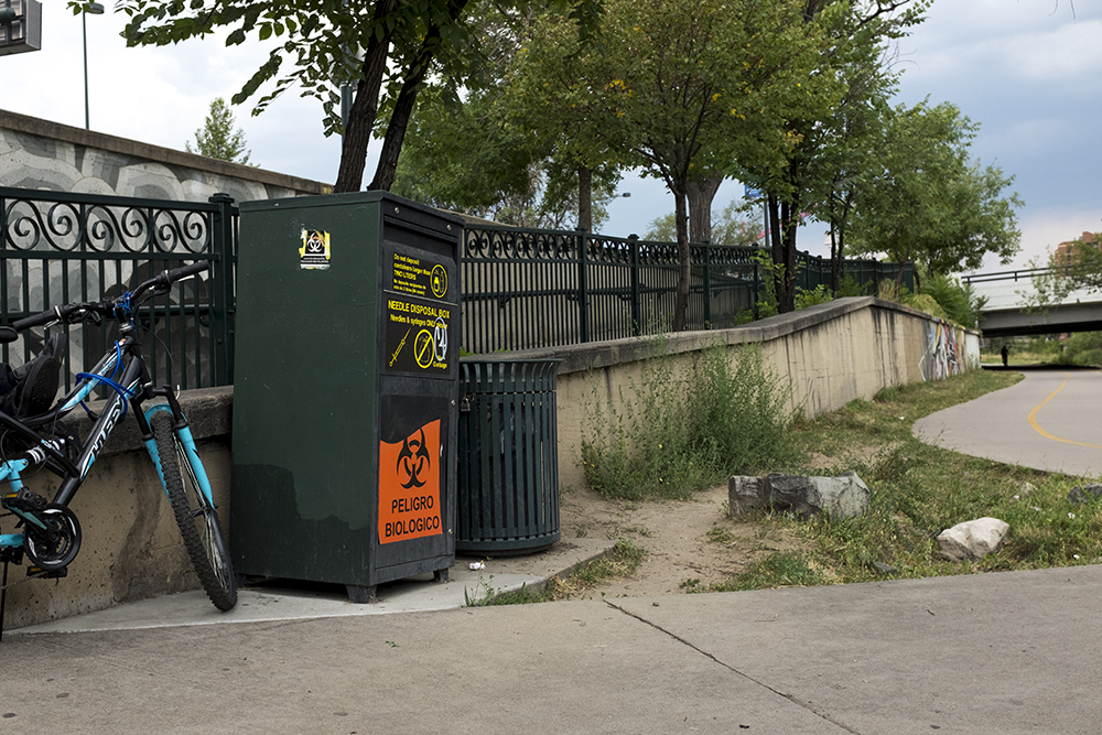 A needle disposal box on the Cherry Creek Trail at Colfax Avenue. (Kevin J. Beaty/Denverite)  heroin; needles; syringe; opioid crisis; denver; denverite; colorado; kevinjbeaty;