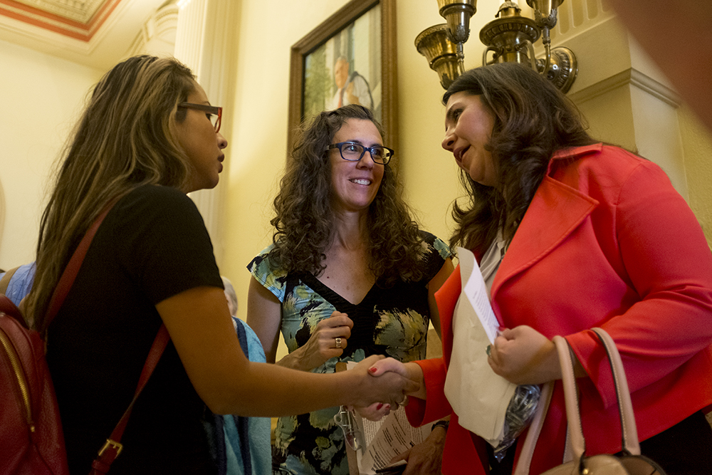 Ingrid Encalada asks Colorado House Speaker Crisanta Duran to sign a letter asking the governor to pardon a felony identity theft charge, which might help her avoid deportation, September 1, 2017. (Kevin J. Beaty/Denverite)