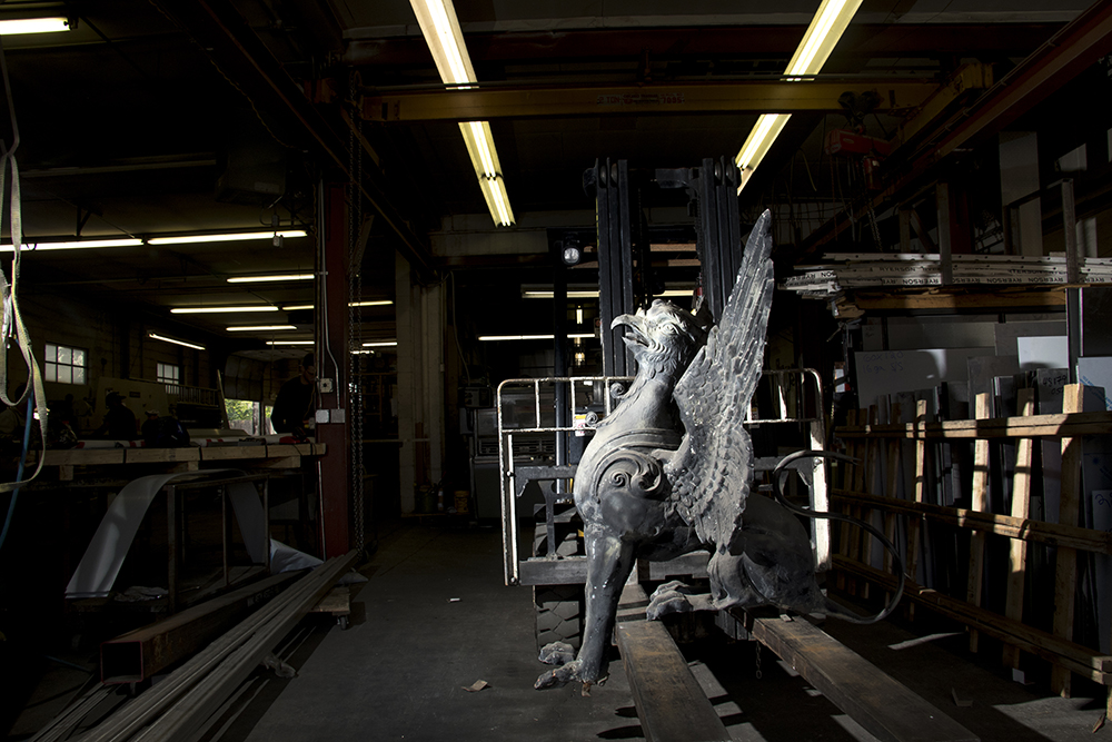 An old Arapahoe Courthouse griffin inside Scherer Metals Inc. on Larimer Street, Sept. 6, 2017. (Kevin J. Beaty/Denverite)  griffin; sculpture; public art; kevinjbeaty; denverite; colorado; denver; five points; rino;