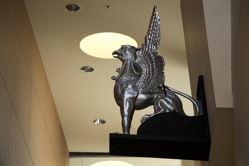 A griffin statue on display above a staircase in the Englewood City Center building. (Kevin J. Beaty/Denverite)  griffin; sculpture; public art; kevinjbeaty; denverite; colorado; denver;