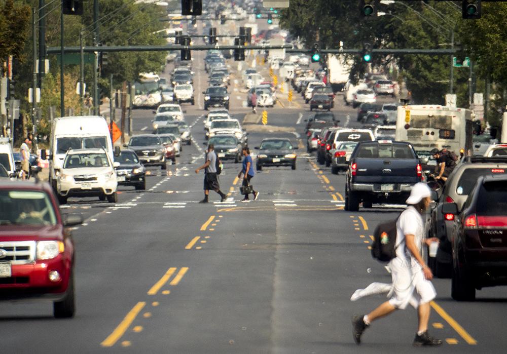 Pedestrians cross East Colfax Avenue, Sept. 7. 2017. (Kevin J. Beaty/Denverite)