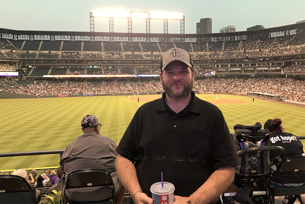 Jerrod Cyboron during a Colorado Rockies trip with the Denver Rescue Mission. (Christian Clark/Denverite)  denver; colorado; colorado rockies; coors field; denver rescue mission; homeless; christian clark;