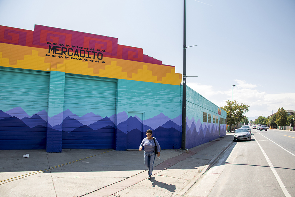 The Westwood Mercadito on Morrison Road, painted by Santiago Jaramillo, Sept. 11, 2017. (Kevin J. Beaty/Denverite)
