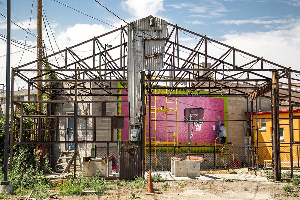 Santiago Jaramillo works on a mural behind La Casita on Morrison Road in Westwood, Sept. 11, 2017. (Kevin J. Beaty/Denverite)  kevinjbeaty; denver; denverite; colorado; morrison road; westwood;