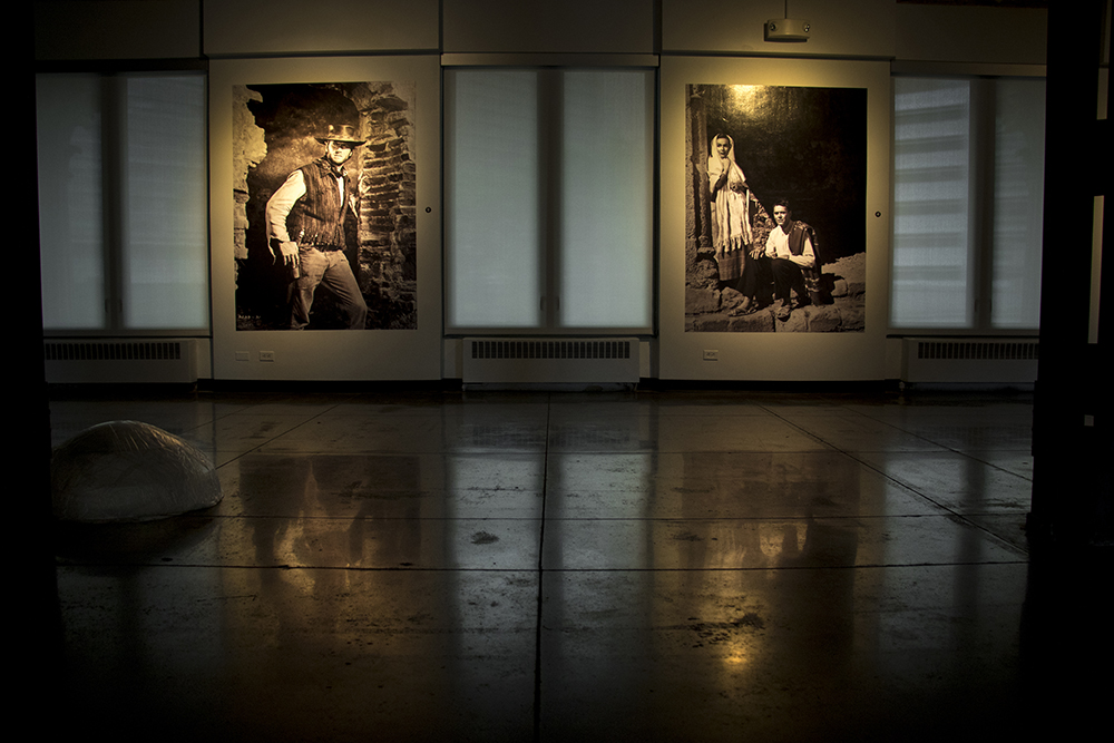 """Images of Clint Eastwood (left) in """"Two Mules for Sister Sarah"""" and Dolores del Río and Henry Fonda in """"The Fugitive,"""" examples of Figureroa's work in America's golden age of cinema. """"Under the Mexican Sky,"""" an exhibit on the work of cinematographer Gabriel Figueroa at the McNichols Building, part of the Biennial of the Americas. Sept. 12, 2017. (Kevin J. Beaty/Denverite)  mcnichols building; art; biennial of the americas; denver; colorado; denverite; kevinjbeaty;"""