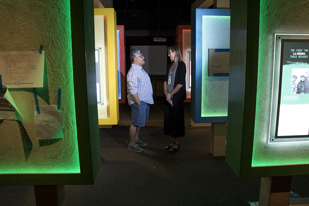 """JJ Rutherford (right) and Daniel Salazar walk through """"El Movimiento,"""" or """"The Movement,"""" as it is installed nearby, Sept. 12, 2017. (Kevin J. Beaty/Denverite)  denver; colorado; denverite; kevinjbeaty; history colorado; chicano;"""