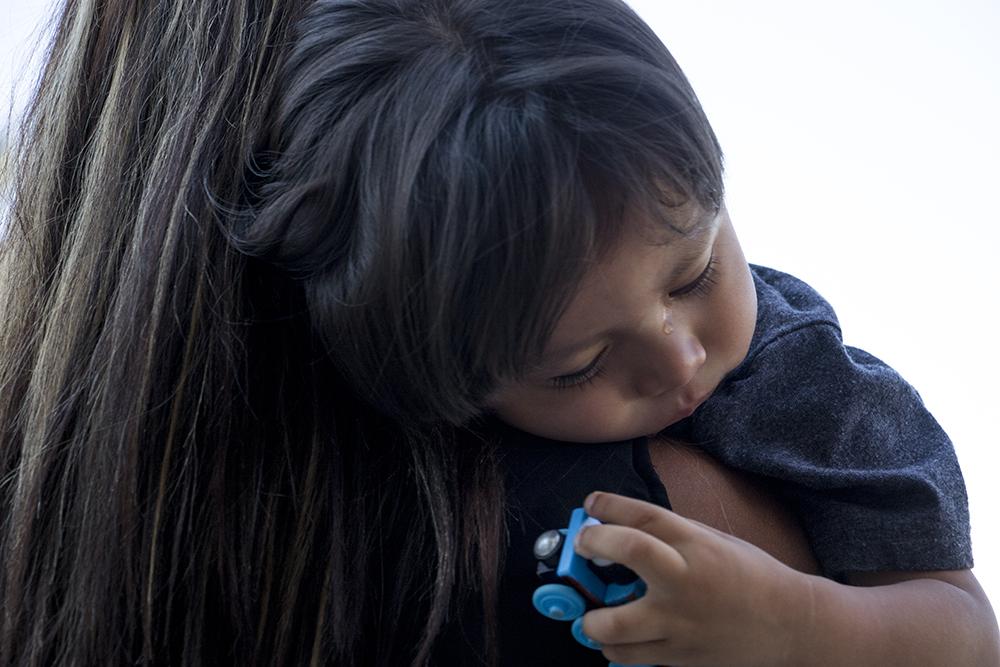 Ingrid Encalada's son Anibal cries on her shoulder during a rally on the Capitol steps asking Governor Hickenlooper for a pardon, Sept. 12, 2017. (Kevin J. Beaty/Denverite)  denver; colorado; denverite; kevinjbeaty;