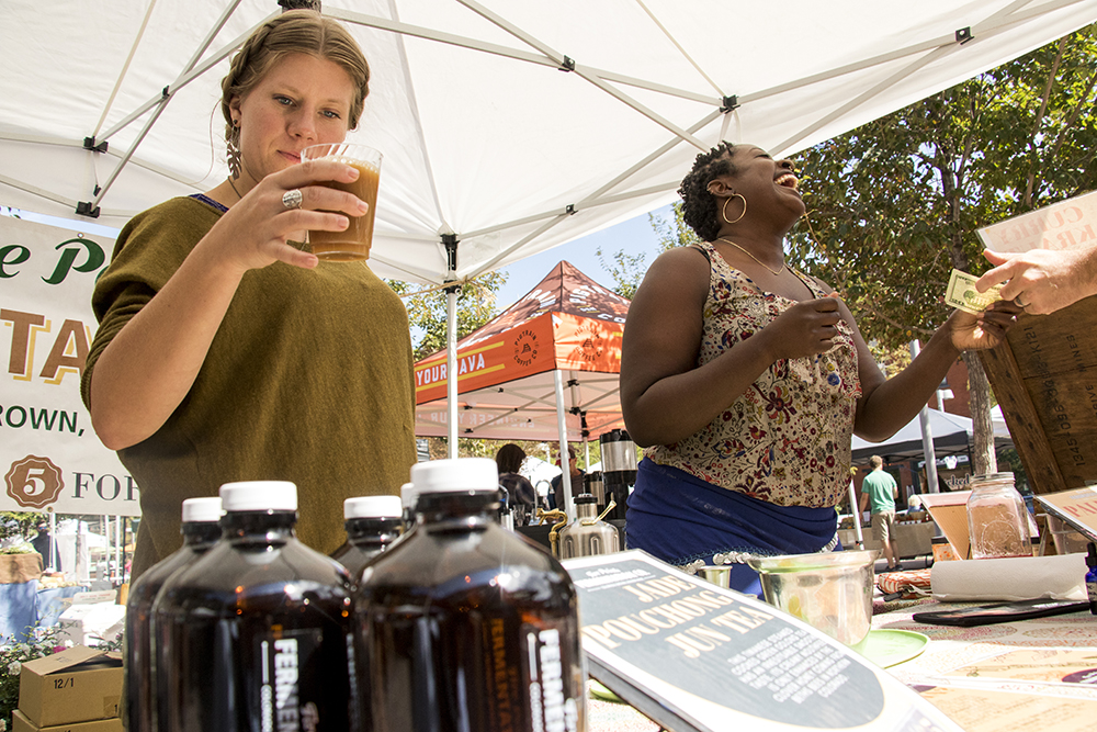 Sarah Shavel (left) and Asia Dorsey at their Five Points Fermentation booth, set up at the Union Station farmers market, Sept. 16, 2017. (Kevin J. Beaty/Denverite)  food; union station; farmers market; gentrification; kevinjbeaty; denverite; colorado; denver;